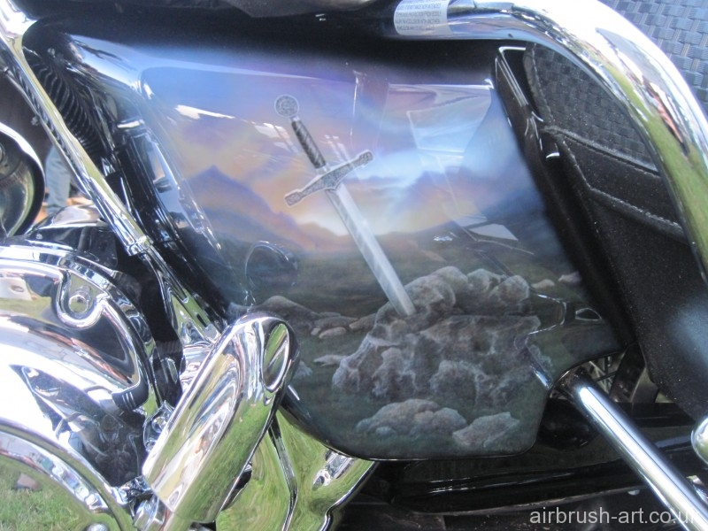 Side panel showing airbrush art of King Arthur sword and stone.