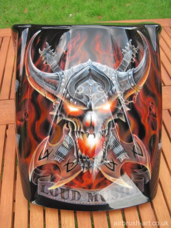 Skull with airbrushed flames and guitar