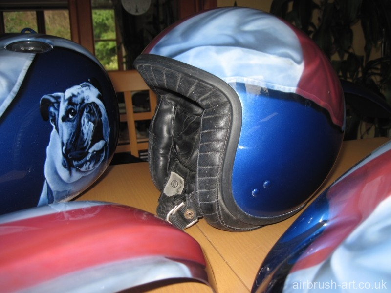 Blue helmet matches the Harley Davidson motorcycle.