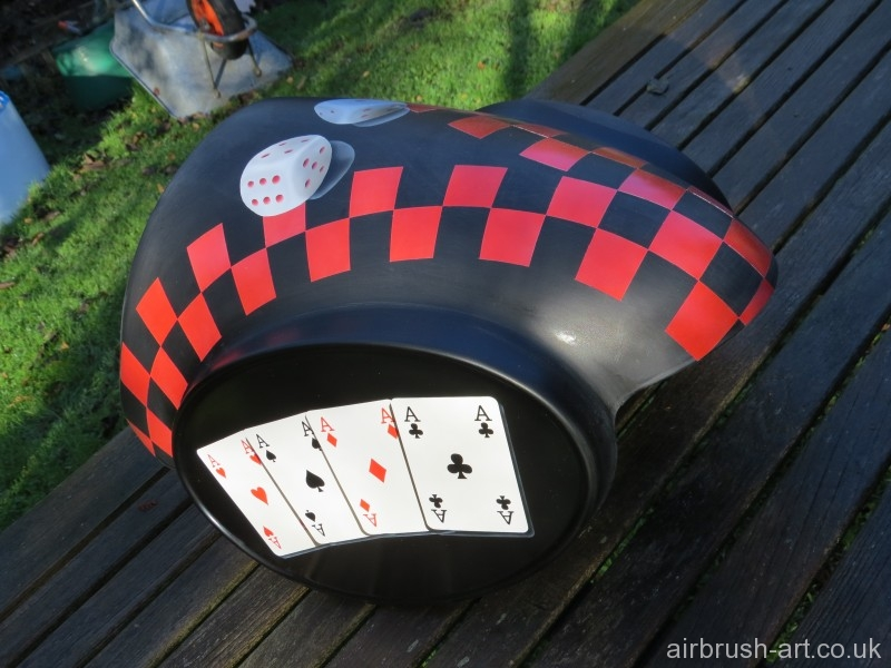 Red checks and die airbrushed on the top of Moto Guzzi panel.