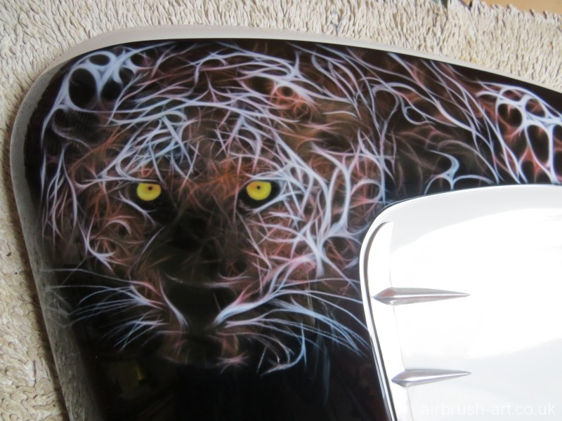 Wild cat on Lambretta panel.