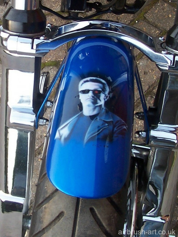 Arnold Schwarzenegger custom paint on motorcycle mudguard.