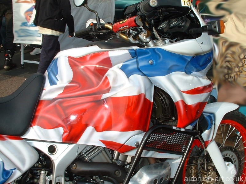 Honda Africa tank with airbrushing of crumpled flag.