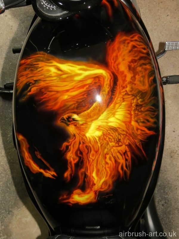 An airbrushed flaming eagle on Harley Davidson tank.