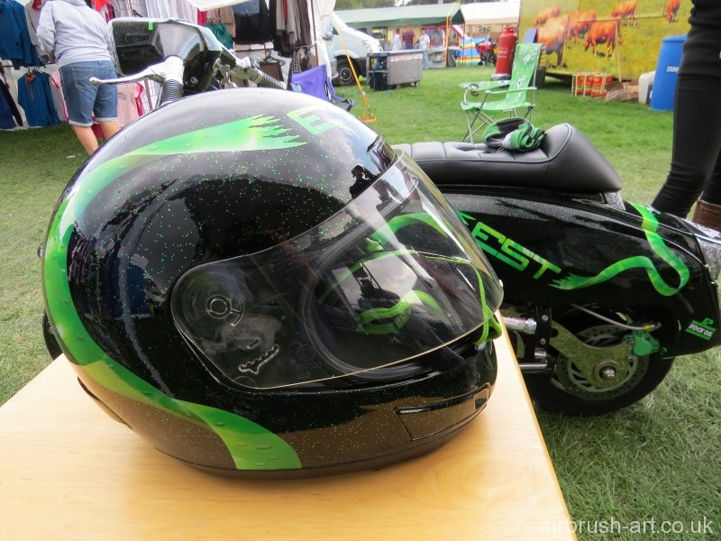 Matching helmet with airbrushed green ribbon.