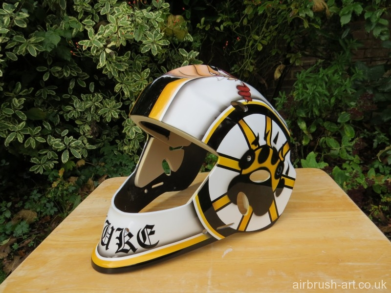 Ice hockey Goalie mask with bear paw print on side.