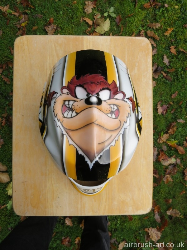 Taz on top of goalie mask.