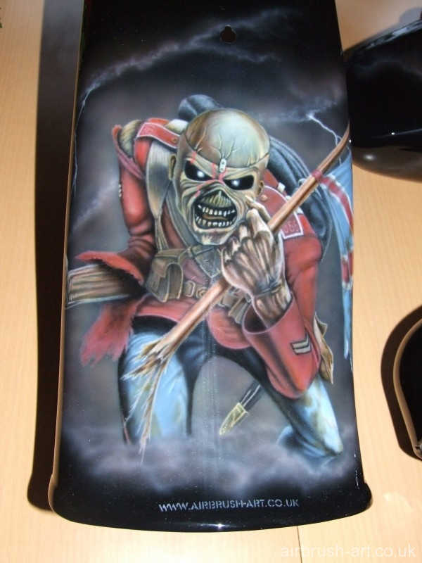 Eddie with flag airbrushed on Harley fender mudguard.