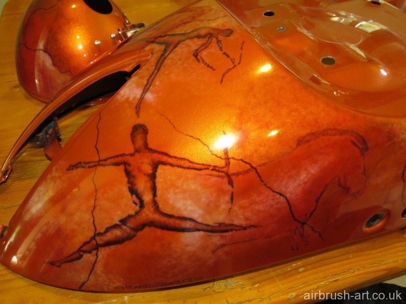 Airbrush artwork on the rear fender of custom painted motorcycle.