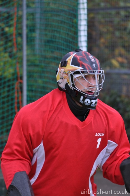 Hockey Goalie with airbrushed hockey helmet mask.