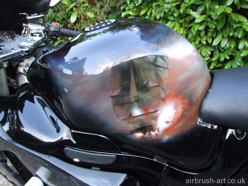 Pirate ship exploding on side of Hayabusa custom painted motorcycle.
