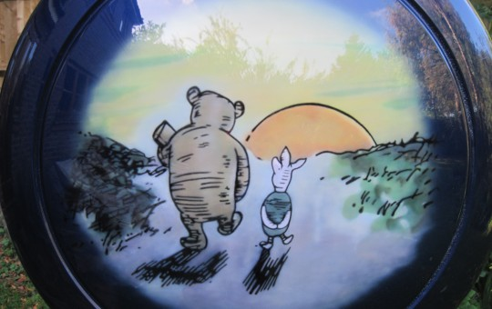 Detail of Pooh and Piglet on hard cover.