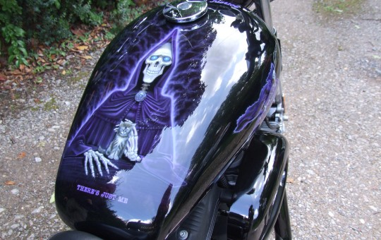 Airbrush art on top of Sportster Harley tank.