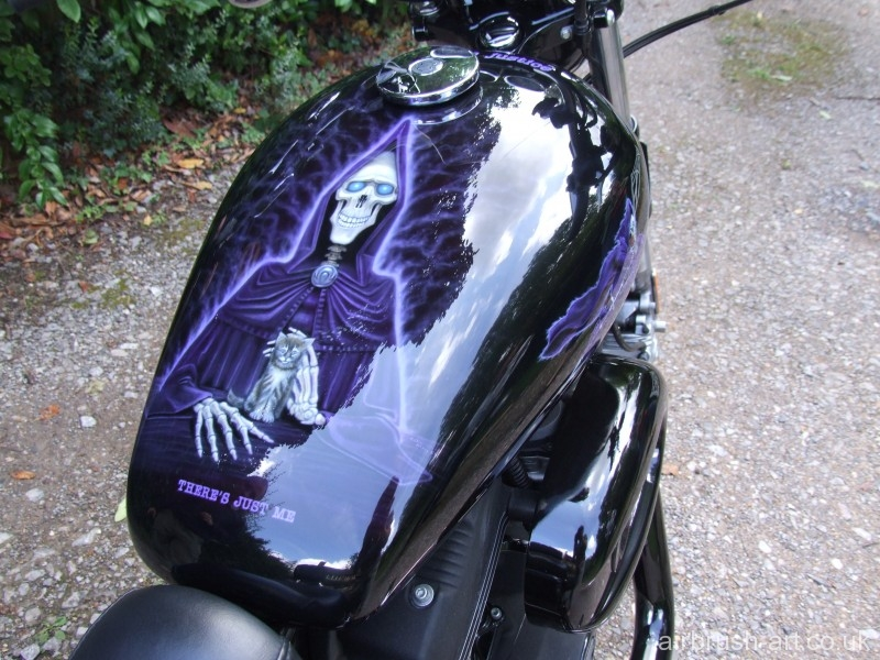 Airbrush art on top of Sportster Harley tank.