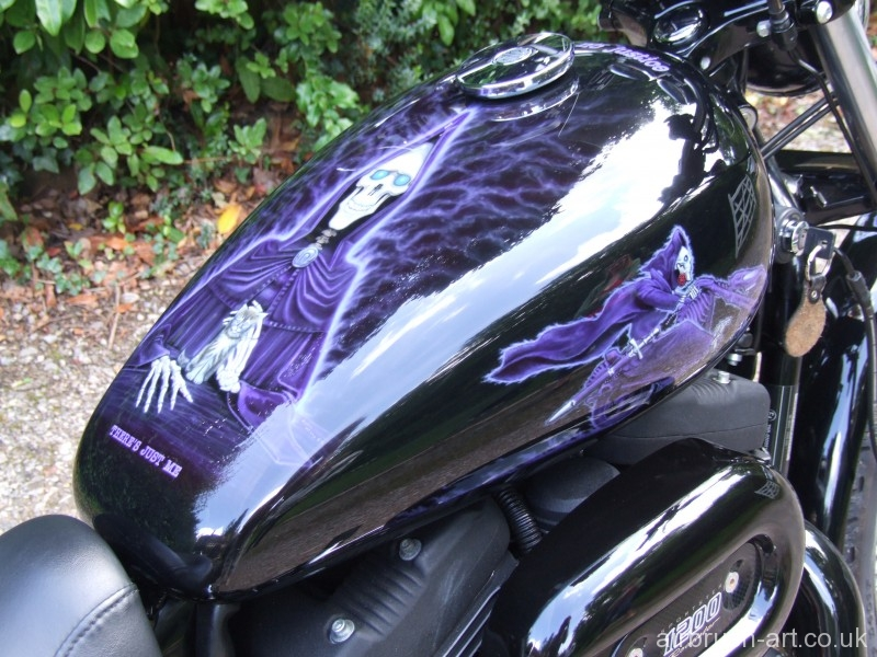 Har;ey Sportster tank with airbrushing of Terry Pratchett characters.