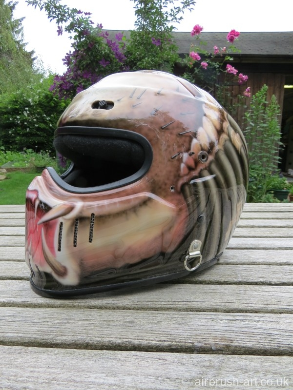 Airbrushing of the Predator on Simpson motorcycle helmet.