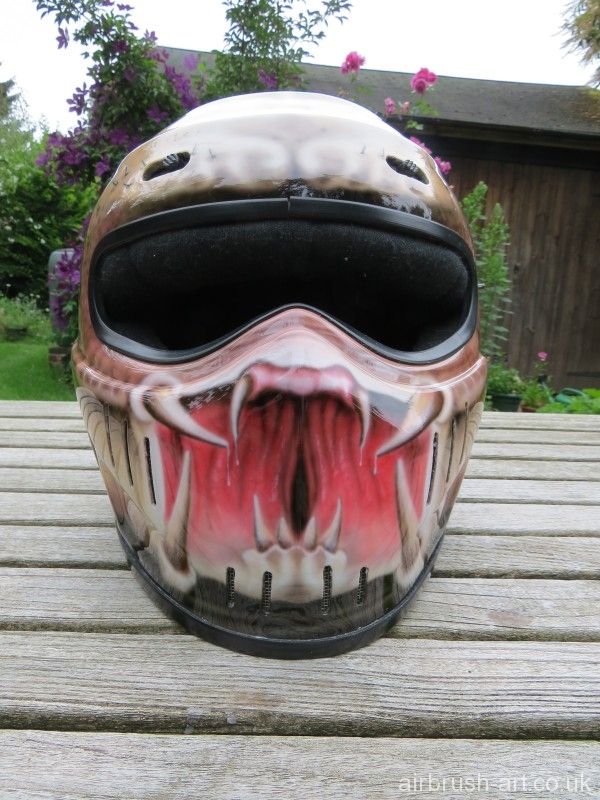 Predator mouth on front of Simpson helmet.