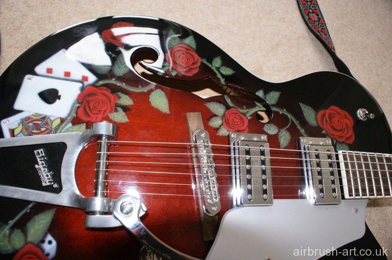 The strung Gretsch guitar with airbrush art.