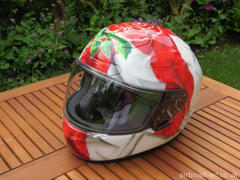 Airbrushed crumpled England flag on helmet.