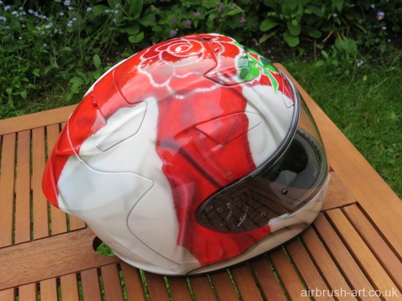 Motorcycle helmet with England rugby rose.
