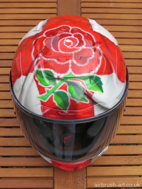 Detailed airbrushing of embroidered badge on top of helmet.