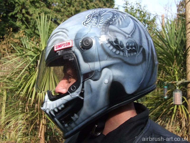 Side view of Simpson skull custom paint helmet.