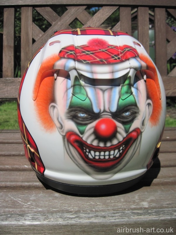 Tartan helmet with clown face on back.