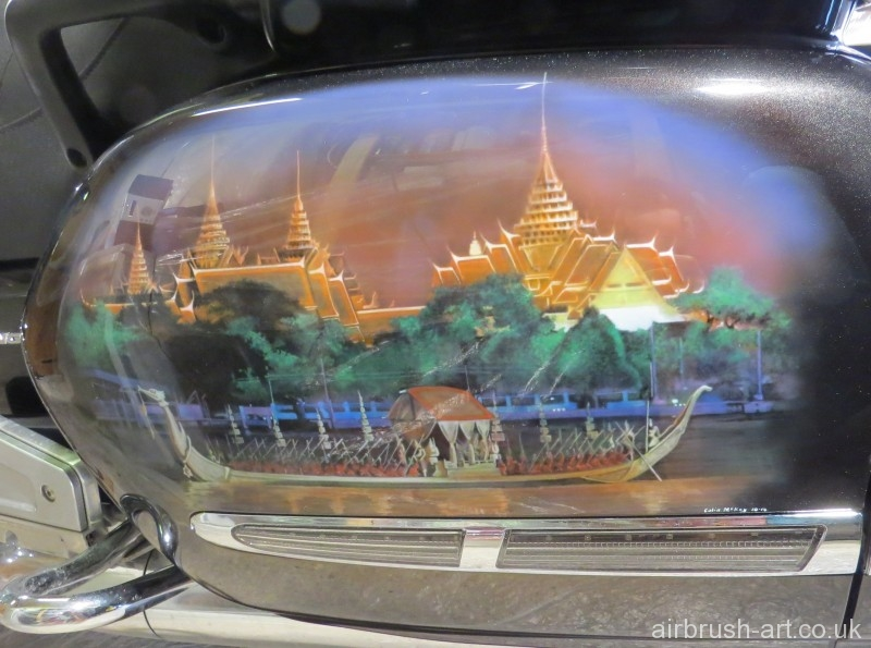 Airbrush Art picture on side panels of a Thai temple and royal boat.