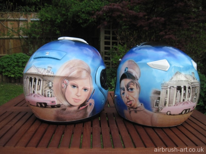 Pair of airbrushed Thunderbird themed helmets.