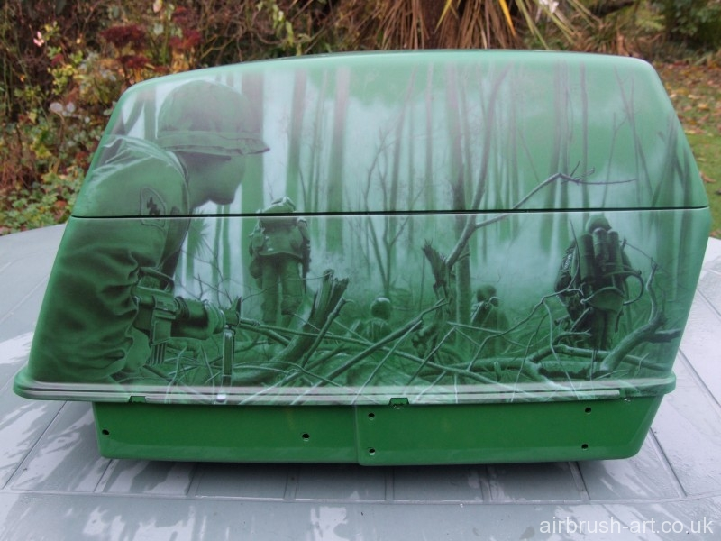 Side luggage box with combat soldiers in Vietnam woods.