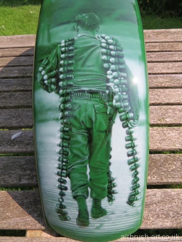 the front mudguard fender with detailed airbrushing of soldier with magazine of bullets.