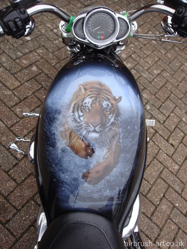 Harley with jumping tiger as seen on the motorcycle.