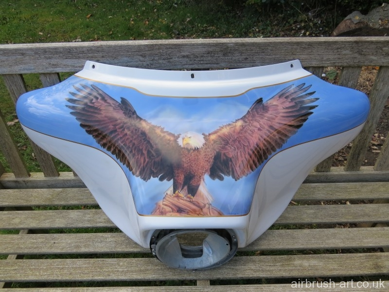 Bald eagle airbrushed onto batwing front fairing of Harley Electra Glide.